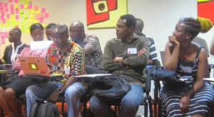 Participants listening to a speaker at the African School of Internet Governance